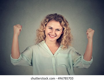 Closeup portrait happy successful woman pumping fists celebrating success isolated on grey wall background. Positive human emotion facial expression