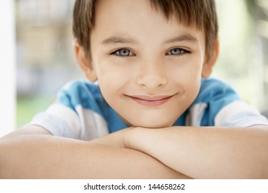 Closeup portrait of happy young boy outdoors