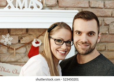 Closeup portrait of happy young couple smiling at xmas time.