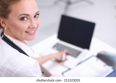 Closeup portrait of a happy young doctor sitting