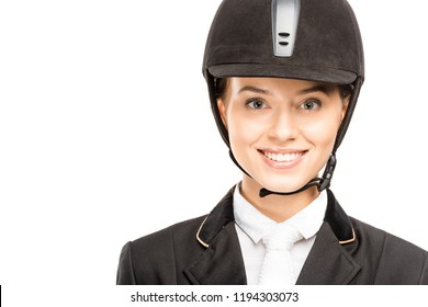 close-up portrait of happy young horsewoman in helmet looking at camera isolated on white