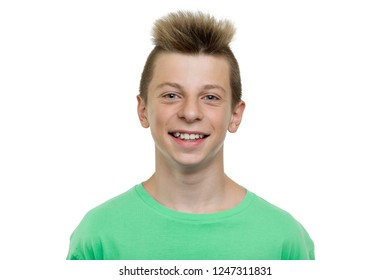 Close-up portrait of happy young laughing teenager boy, smile with teeth, white background isolated.