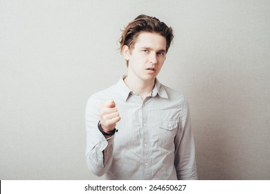 Closeup portrait happy young man giving thumb, finger fig gesture you are going to get zero nothing. Pozitive emotions, facial expressions, feelings, body language, signs