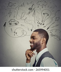 Closeup portrait happy young man has many ideas isolated on gray wall background
