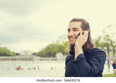 Closeup portrait happy young man talking on mobile phone