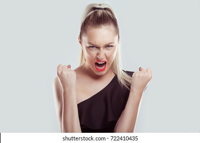 Closeup portrait head shot angry young woman having nervous breakdown screaming isolated white wall background. Negative human emotion facial expression feeling attitude