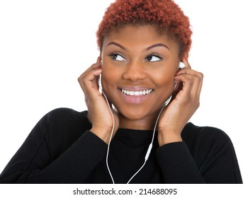 Closeup portrait, headshot beautiful happy young woman with ear buds, earphones listening to music on sound player, isolated white background. Positive emotions, facial expressions, feelings, leisure