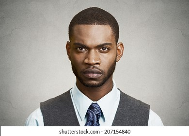 Closeup portrait, headshot handsome serious corporate business man looking at you gesture skeptically, isolated black background. Negative human emotions, facial expression, feeling, body language