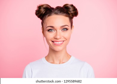 Close-up portrait of her she nice attractive lovable cute adorable winsome cheerful cheery girl with buns isolated over pink pastel background