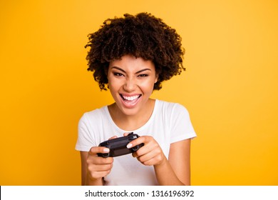 Close-up portrait of her she nice cute attractive stylish crazy cheerful cheery wavy-haired lady playing video game spending free time isolated on bright vivid shine yellow background