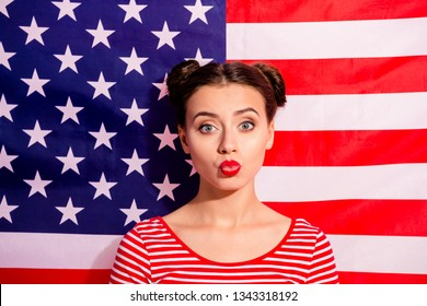 Close-up portrait of her she nice cute charming attractive winsome sad disappointed teen girl wearing striped t-shirt sending you air kiss isolated over american flag background
