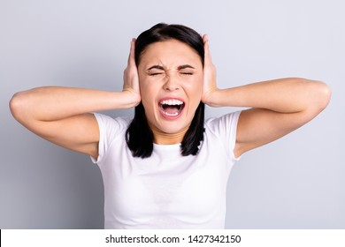 Close-up portrait of her she nice attractive desperate crazy mad girl showing disagree avoid scandal unbearable loud sound dislike noisy uproar roar isolated over light gray pastel background