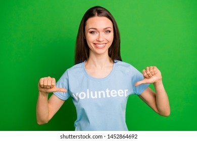 Close-up portrait of her she nice attractive cheerful cheery straight-haired girl wearing printed tshirt pointing at herself best choice choose isolated over bright vivid shine green lime background