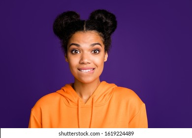 Close-up portrait of her she nice attractive curious cheerful unsure puzzled brunette girl wearing hoody deciding biting lip isolated on bright vivid shine vibrant lilac violet purple color background