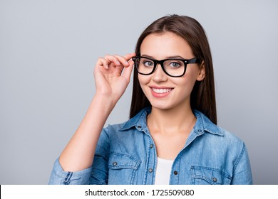 Close-up portrait of her she nice attractive lovely charming winsome cheerful cheery content brown-haired girl wearing touching accessory specs isolated over grey pastel color background