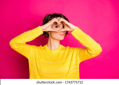Close-up portrait of her she nice attractive dreamy pretty cute shy feminine cheery girl showing heart symbol sign looking at you isolated bright vivid shine vibrant pink fuchsia color background