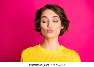 Close-up portrait of her she nice attractive lovely dreamy sweet pretty lovable cute shy feminine cheery girl sending air kiss isolated on bright vivid shine vibrant pink fuchsia color background