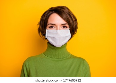 Close-up portrait of her she nice pretty girl wearing gauze safety mask stop contagious ncov cov mers pneumonia syndrome cdc isolated bright vivid shine vibrant yellow color background