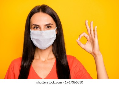 Close-up portrait of her she nice attractive confident lady showing ok-sign advert therapy flue grippe pandemia china wuhan healthcare viral pneumonia isolated yellow color background