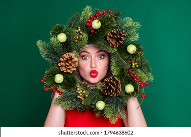 Close-up portrait of her she nice attractive pretty flirty coquettish funky girl holding in hands festive wreath having fun sending air kiss good mood isolated over green color background