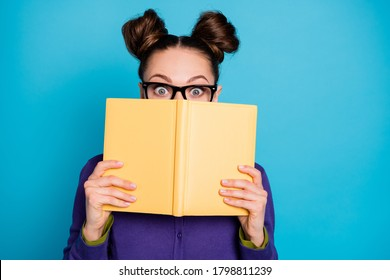 Close-up portrait of her she nice attractive smart clever funny shy schoolgirl hiding behind diary book home task isolated on bright vivid shine vibrant blue green teal turquoise color background