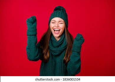 Close-up portrait of her she, nice attractive ecstatic dreamy cheerful cheery girl wear wool knit rejoicing celebrating great luck isolated over bright vivid shine vibrant red color background