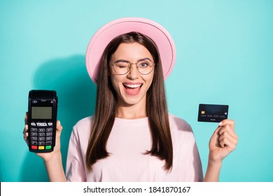 Close-up portrait of her she nice attractive cheerful cheery glad girl client holding in hands atm card reader winking isolated bright vivid shine vibrant green turquoise color background