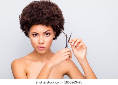 Close-up portrait of her she nice attractive lovely mad angry irritated wavy-haired girl holding in hands scissors cutting messy curl haircut isolated on light white gray color pastel background