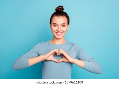 Close-up portrait of her she nice-looking cute attractive lovely winsome cheerful cheery girl showing heart gesture isolated over bright vivid shine turquoise background