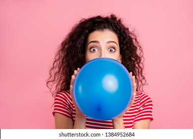 Close-up portrait of her she nice-looking attractive lovely winsome funny wavy-haired lady blowing blue ball festal event occasion isolated over pink pastel background