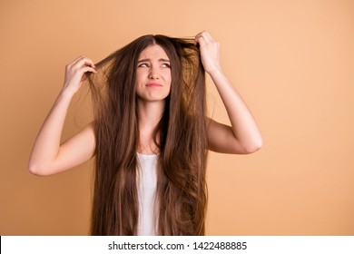 Close-up portrait of her she nice-looking attractive displeased miserable lady showing despair repair loose lose loss alopecia mess hair disaster isolated on beige pastel background