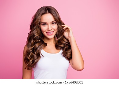 Close-up portrait of her she nice-looking attractive lovely lovable pretty cute winsome gorgeous cheerful cheery wavy-haired girl touching curls isolated over pink pastel color background