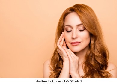 Close-up portrait of her she nice-looking attractive lovely sweet gentle shine wavy-haired lady enjoying touching smooth soft flawless cheek laser plastic surgery isolated over beige background