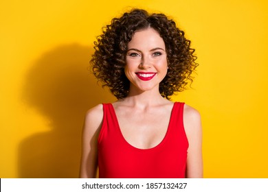 Close-up portrait of her she nice-looking attractive lovely charming grogeous glamorous cheerful wavy-haired girl wearing tanktop isolated bright vivid shine vibrant yellow color background