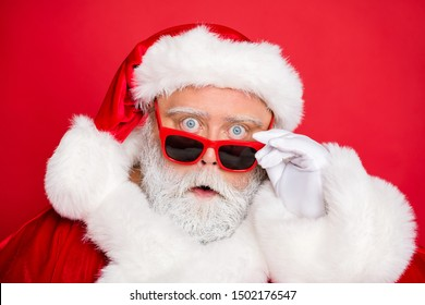 Close-up portrait of his he amazed stunned funky fat overweight plump gray-haired bearded man incredible news putting specs off isolated over bright vivid shine red background