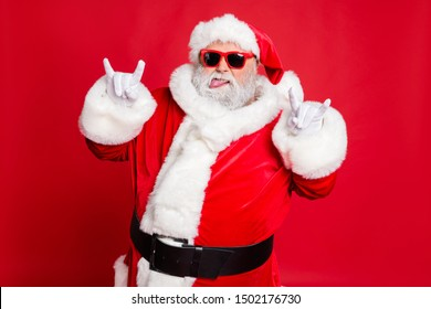 Close-up portrait of his he confident naughty fat overweight plump gray-haired bearded man having fun time showing horn sign symbol rock roll isolated over bright vivid shine red background