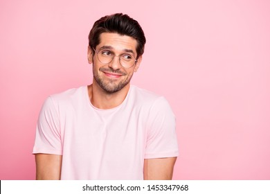 Close-up portrait of his he nice attractive lovely cheerful cheery intelligent shy guy wearing specs don't know what to do isolated over pink pastel background