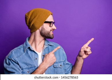 Close-up portrait of his he nice attractive confident cheerful cheery glad bearded guy pointing two forefingers aside ad advert solution isolated over bright vivid shine violet lilac background