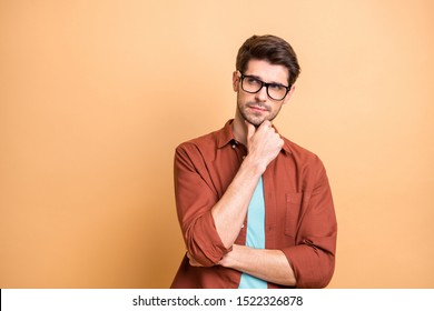 Close-up portrait of his he nice attractive serious focused minded brown-haired guy experienced professional financier economist thinking touching chin isolated over beige color pastel background