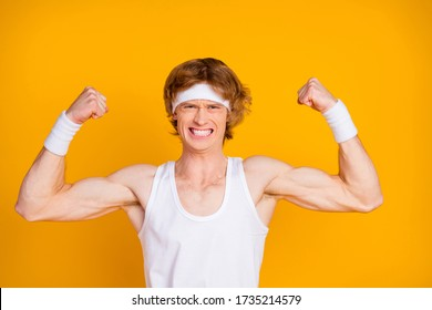 Close-up portrait of his he nice attractive discontent sportive guy sportsman forcing struggling showing muscles motivation isolated over bright vivid shine vibrant yellow color background