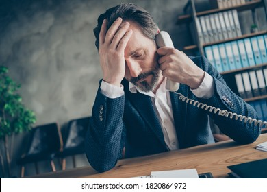 Close-up portrait of his he sullen miserable jobless middle-aged guy executive director employee talking on phone crisis cost reduction at modern loft industrial style interior workplace workstation