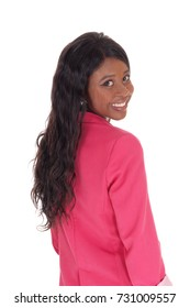 A closeup portrait image of a African American woman in a pinkjacket, smiling, from the back, isolated for white background