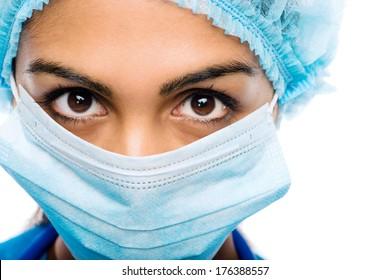 Closeup portrait Indian woman Doctor surgeons serious white background