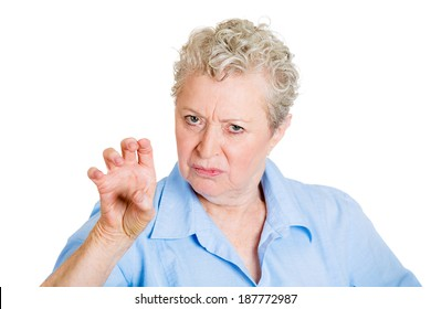 Closeup portrait, irritated, unhappy, angry mad senior mature woman, threatening someone with claws, nails, isolated white background. Negative human emotions, facial expressions, feeling, reaction