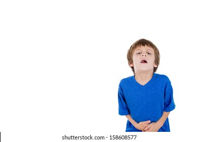Closeup portrait of kid doubled over in pain clutching stomach with hands, isolated on white background with copy space