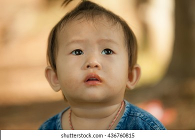 closeup portrait of kid in thailand