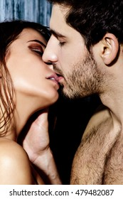 Close-up portrait of a kissing passionate young people in love.