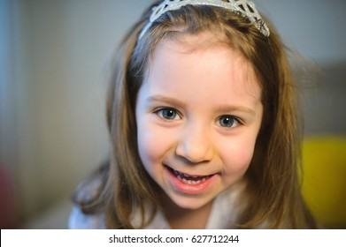 closeup portrait of laughing girl in crown