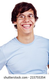 Close-up portrait of laughing young man in glasses and blue t-shirt isolated on white background