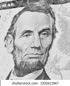 Close-up portrait of Lincoln on dollar bill